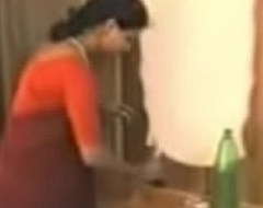 red saree lady removing duds and loving with young guy.3GP