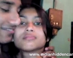 Bangla indian chick in brassiere giving a kiss bigtits in nature's wardrobe